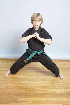Young, male, green belt, Karate student greeting the room Stock Photo