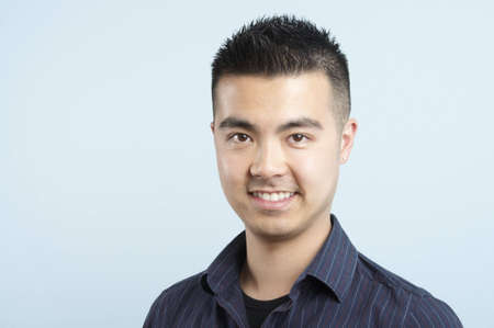 head and shoulders of a smiling young Asian male