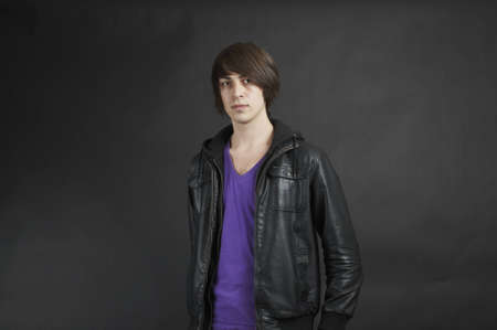 A young adult upper body pose wearing a leather jacket Stock Photo - 9834327