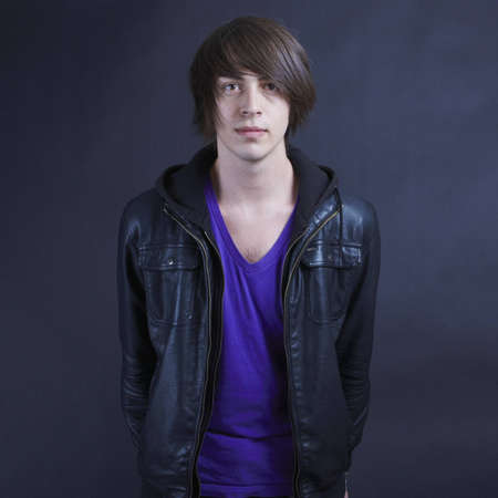 facing to camera: Young man wearing a leather jacket facing the camera Stock Photo