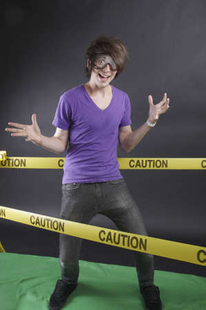 manic: Young man wearing goggles in an excitable state Stock Photo