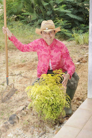 Woman with a shrub she has just planted