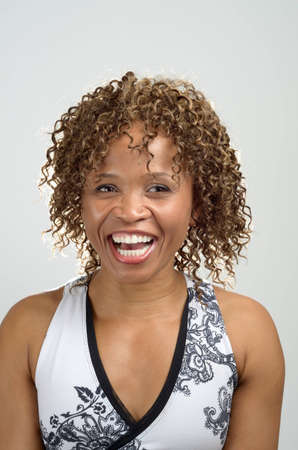 Head shot of a woman laughing photo