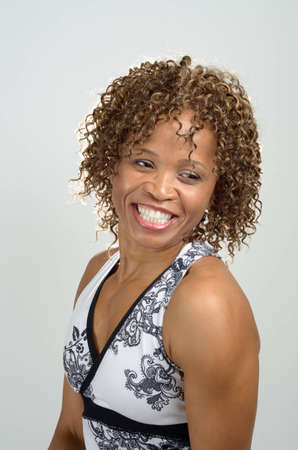 Three quarter view head and shoulders shot of a smiling woman