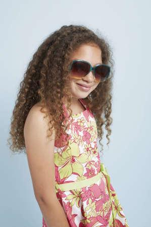 Mixed race young girl wearing sunglasses