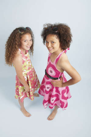 Two mixed race girls together in summer dresses Stock Photo - 15506658