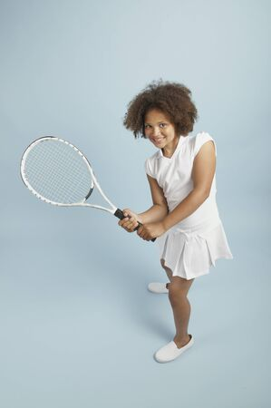 Mixed race young tennis girl ready to play photo