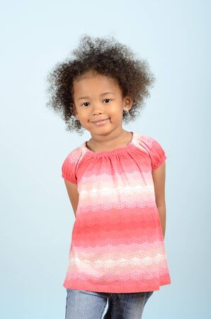 three quarter length: Three quarter length portrait of young mixed race girl