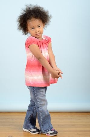 Mixed race girl in full length standing pose