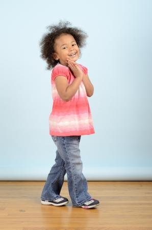 full length portrait of mixed race girl