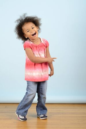 Mixed race girl laughing
