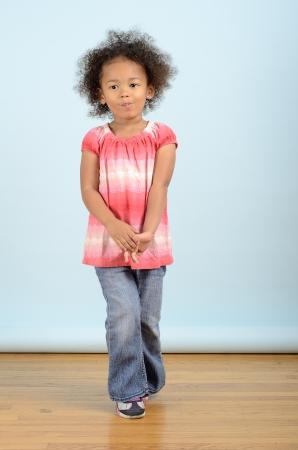 Mixed race girl standing