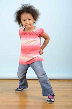 Mixed race little girl stikes a pose