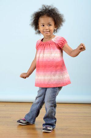Little girl doing a dance