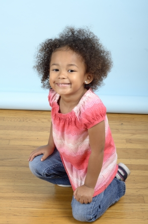 Mixed race girl smiling into camera