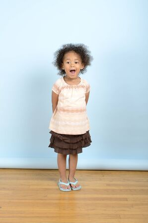 Mixed race girl with a surprised expression
