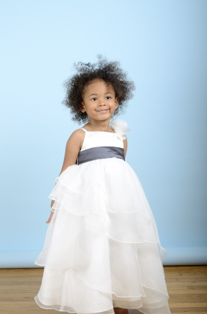 little girl wearing a white formal dress