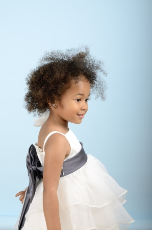 Little girl in formal dress from the side