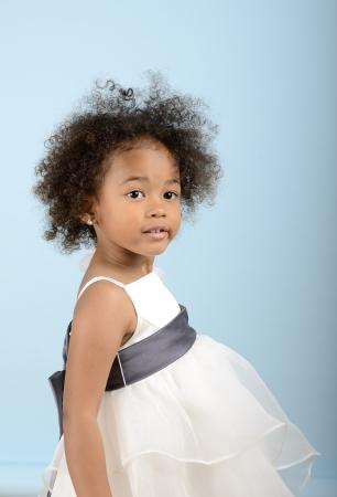 Side shot of little girl in white formal dress Stock Photo - 18061236