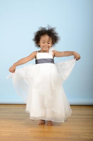 Little girl dances in her white formal dress Stock Photo - 18061229