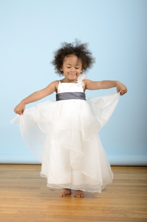 Little girl dances in her white formal dress Stock Photo - 18061229