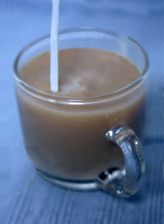 Pouring cream into your coffee