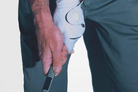 A pro golfer gripping a club