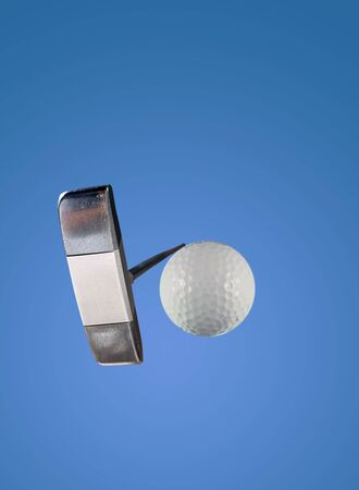 looking up at a putter about to stick a golf ball