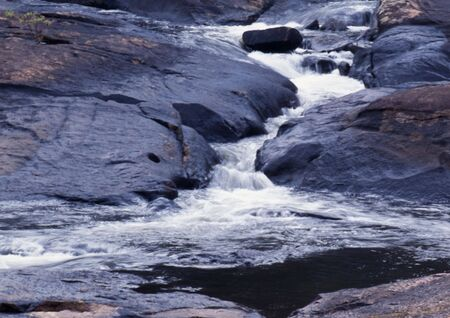 small stream cascading between two rock formations