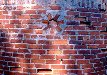 old red brick circular wall with hole