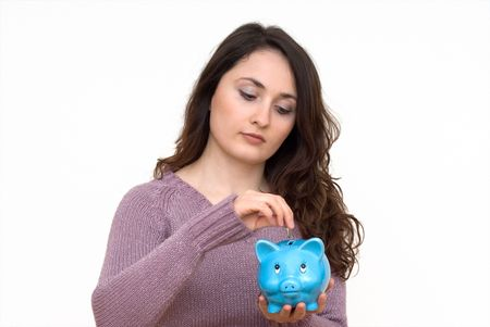 future earnings: A young attractive woman with blue piggy-bank