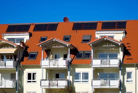outdoor electricity: A house with solar cells on the roof