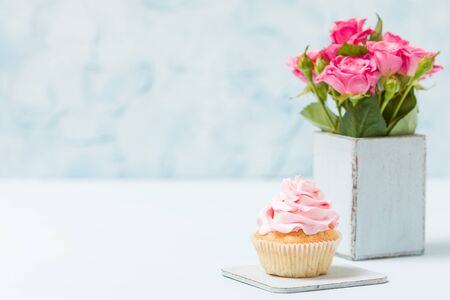 Cupcake With Pink Decoration And Bouquet Of Pink Roses In Retro