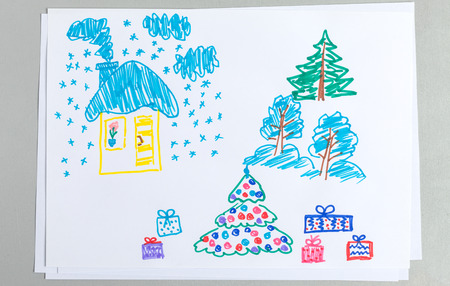 Kid drawing of winter Christmas and New Year scenes with covered with snow house and trees with gift boxes on white background - child colorful scribble doodle of holiday elements. Stock Photo