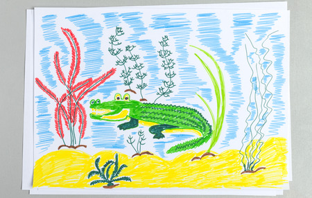 Kid doodle of cute crocodile underwater on sand bottom with seaweeds