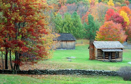 log house: Fall peak season scene in the mountains with cabin and barn