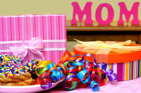 Mothers Day gifts, treat and MOM in background photo