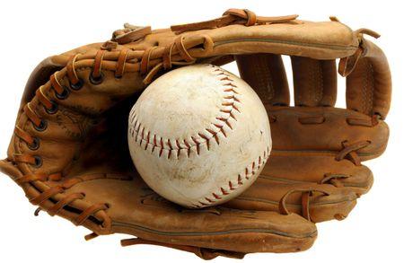 Old and warn baseball mitt with ball photo
