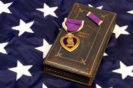 Vintage WWII Purple Heart on Flag photo