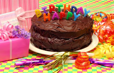 poppers: Cake, Fudge Icing and Party Set Up Stock Photo
