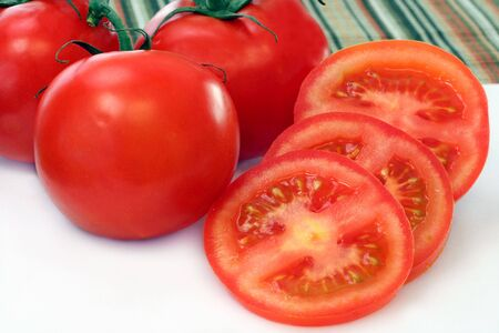 Whole and Sliced Vine Tomatoes Stok Fotoğraf