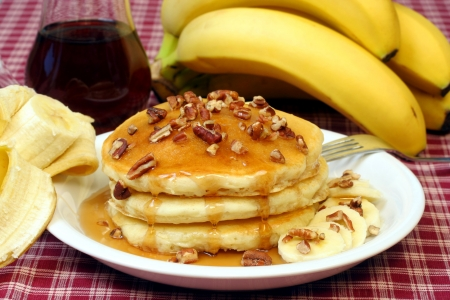 Pancakes with Syrup Running, Pecans and Bananas
