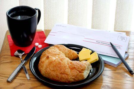 Croissant, Coffee and Bills 版權商用圖片