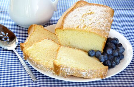 Pound cake whole and slice with blueberries