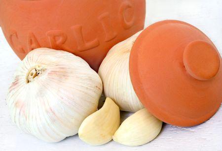 Clay Garlic Pot and Garlic on White Weathered Board