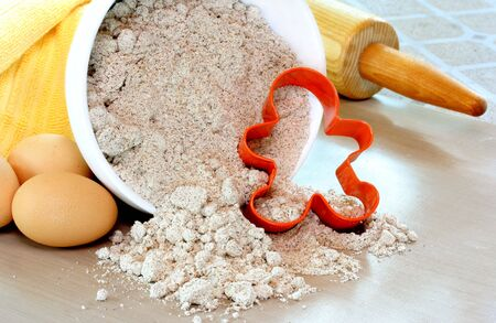 gingerbreadman: Gingerbread flour, cutter, eggs and rollingpin  Stock Photo