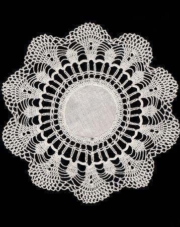 Vintage Crochet Doiley Isolated on Black