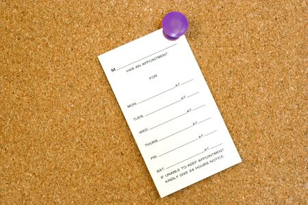 Blank Appointment Card on Cork Board