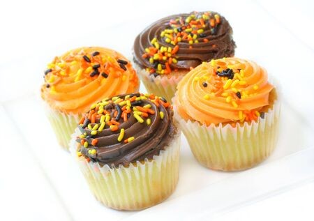 Halloween Decorated Cupcakes on White photo