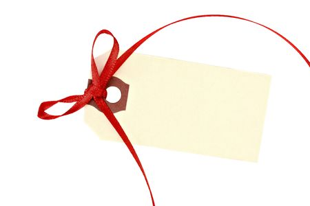 One beige tag with a red ribbon isolated on white with copy space.
